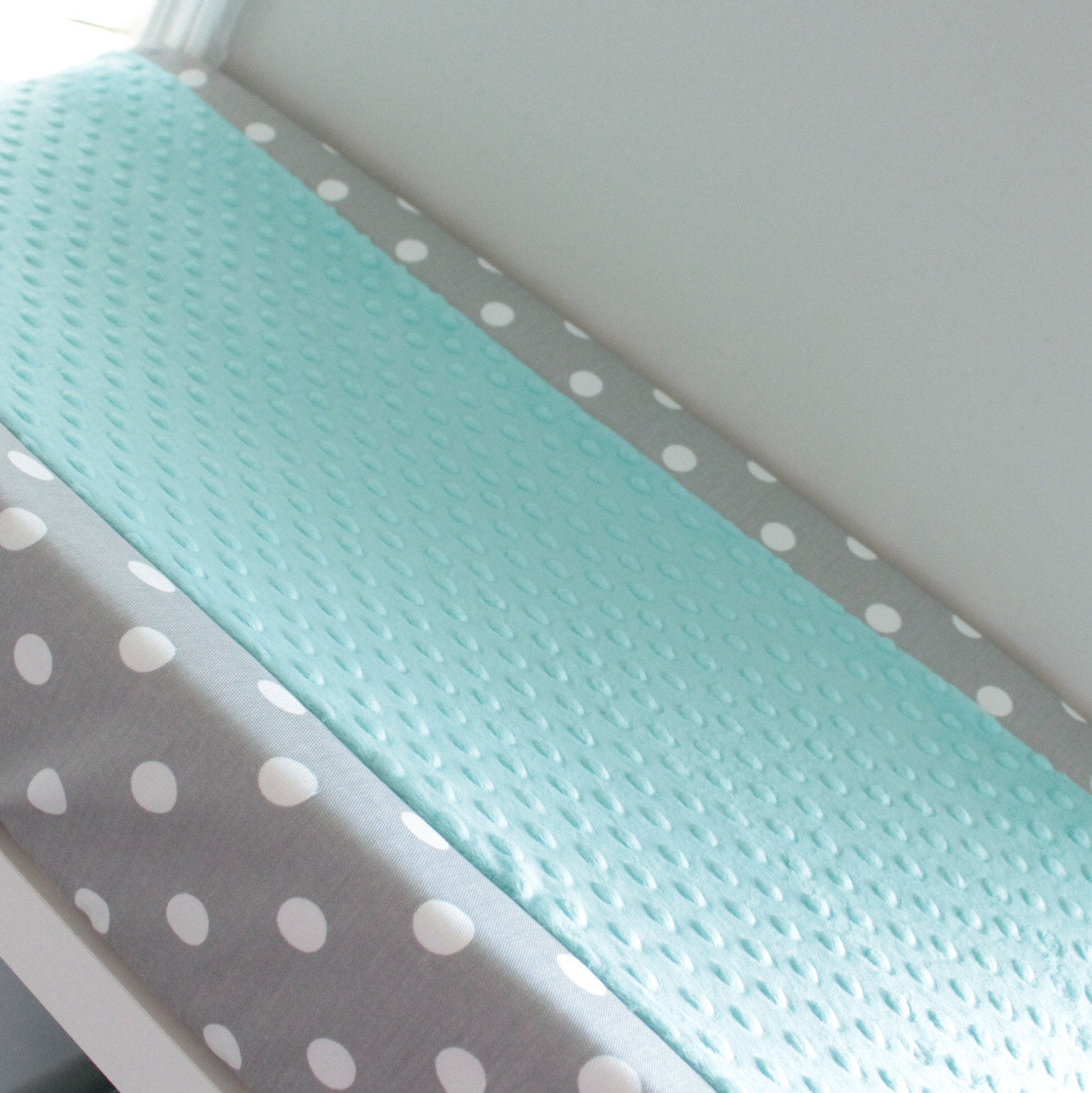 Custom White and Gray polka dot contour cover with accent minky.