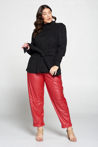 livd plus size boutique plus size girl wearing black wrap sweater top and red faux leather pants