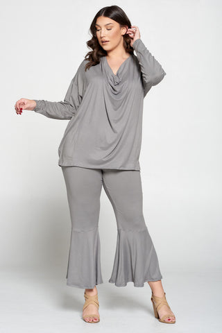 plus size clothing store livd. model wearing two piece comfortable set with draped top and flare pants