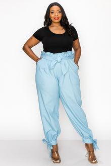 livd apparel plus size boutique contemporary paperbag denim pants with waist tie and leg cuff ribbons in light blue
