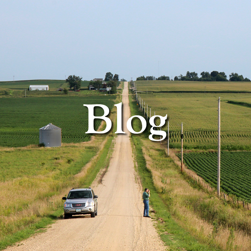 Benjamin Chait's Blog. A straight and rolling gravel road between Iowa farm fields.