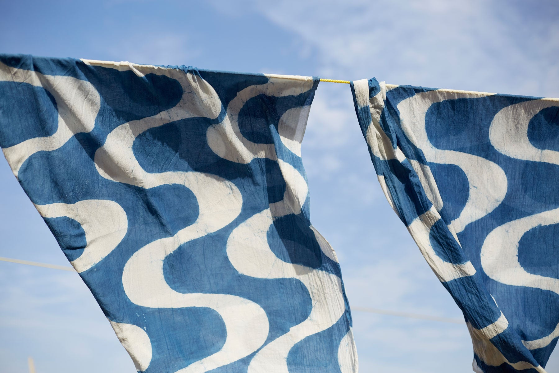 Hand block printed indigo dyed textiles drying outside