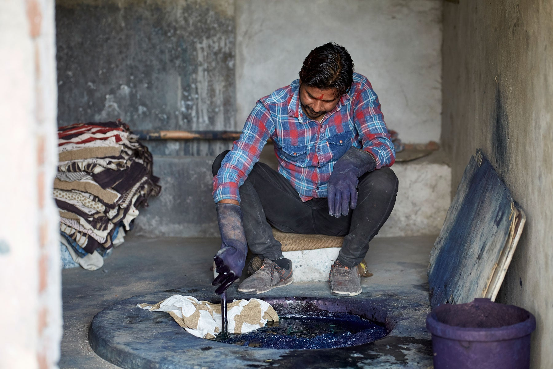 Dipping hand block printed textiles in the indigo vat