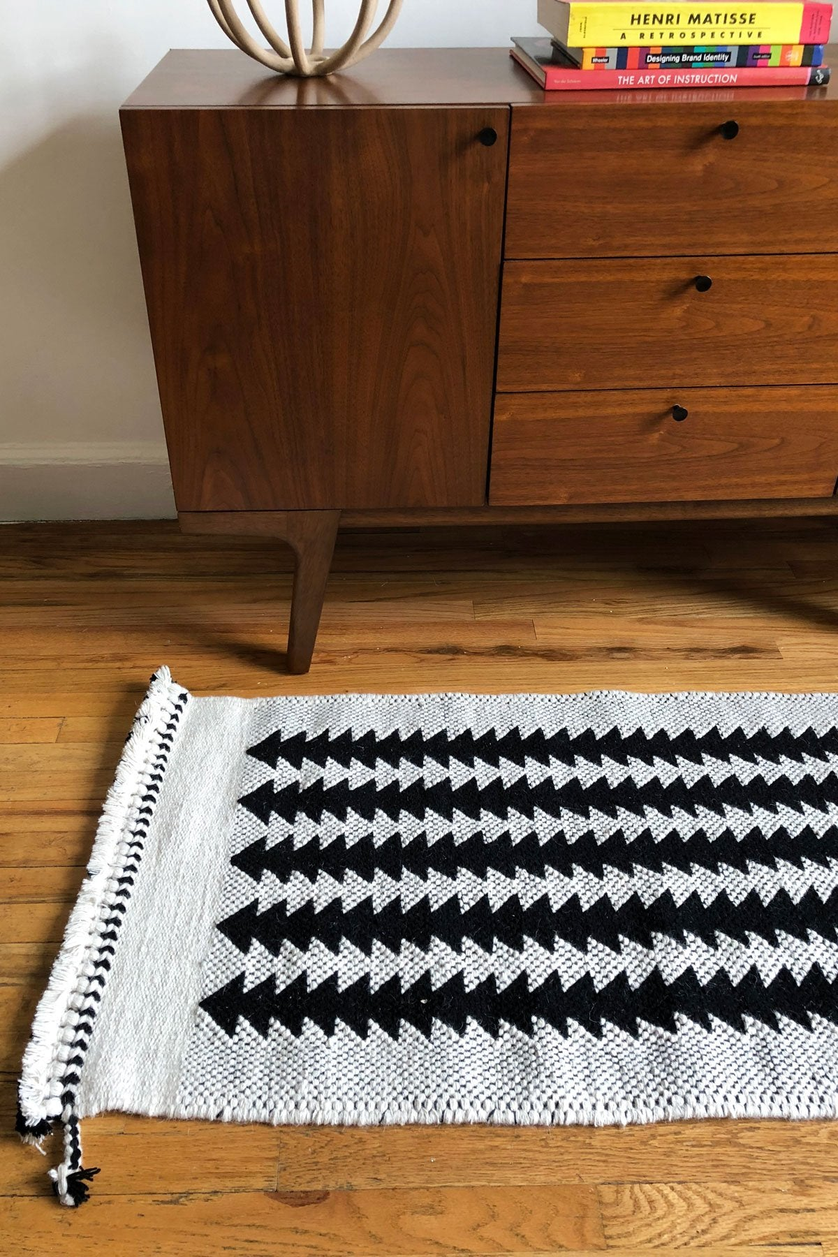 Black and white neutral wool runner rug. Handwoven with undyed wool. Perfect for next to a bed or in front of a dresser.
