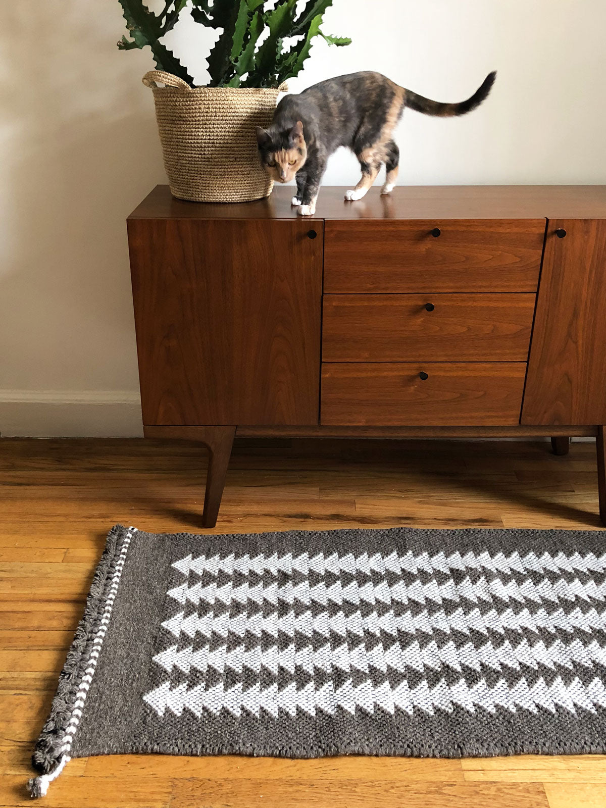 SUNDAY/MONDAY handwoven runner rug in slate and white. Handmade by 5th generation master weavers using undyed sheep wool. 2x5'