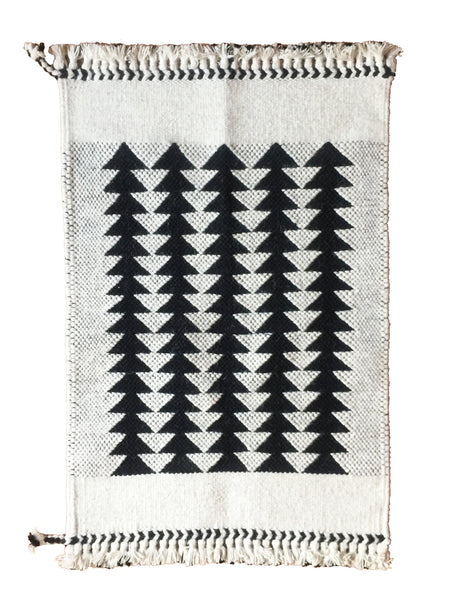 Our bestselling Arrows 2x3' rug, handwoven with 100% undyed wool in Gujarat, India. There are only 3 families left doing this type of weaving. Each rug takes 2 days to make. Looks just as beautiful on the wall as the floor.