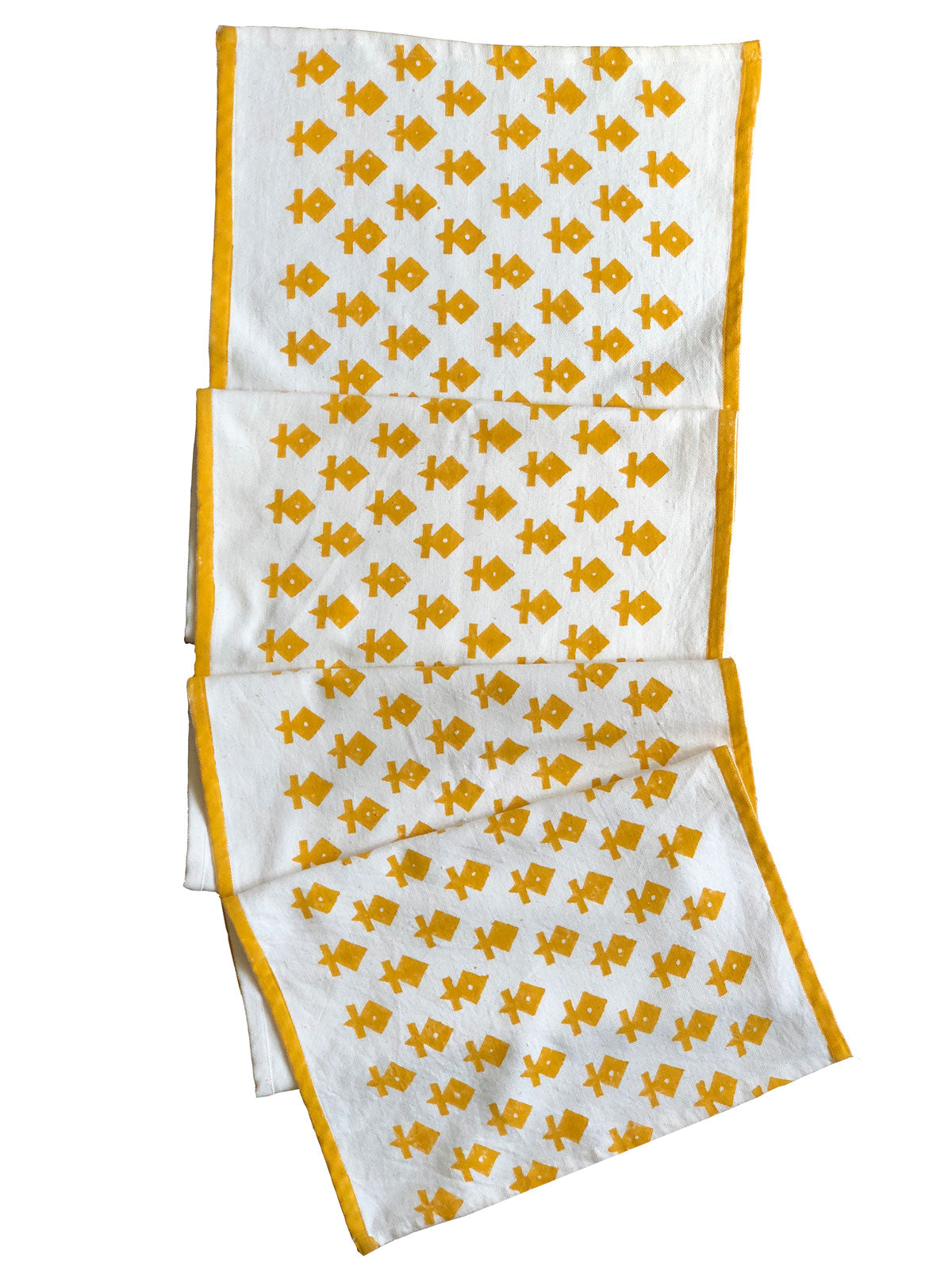 A gorgeous mustard colored handwoven, hand block printed table runner - perfect for spring and summer table tops. Ethically handmade by artisans in Gujarat, India. Your support helps preserve the ancient craft traditions of India.