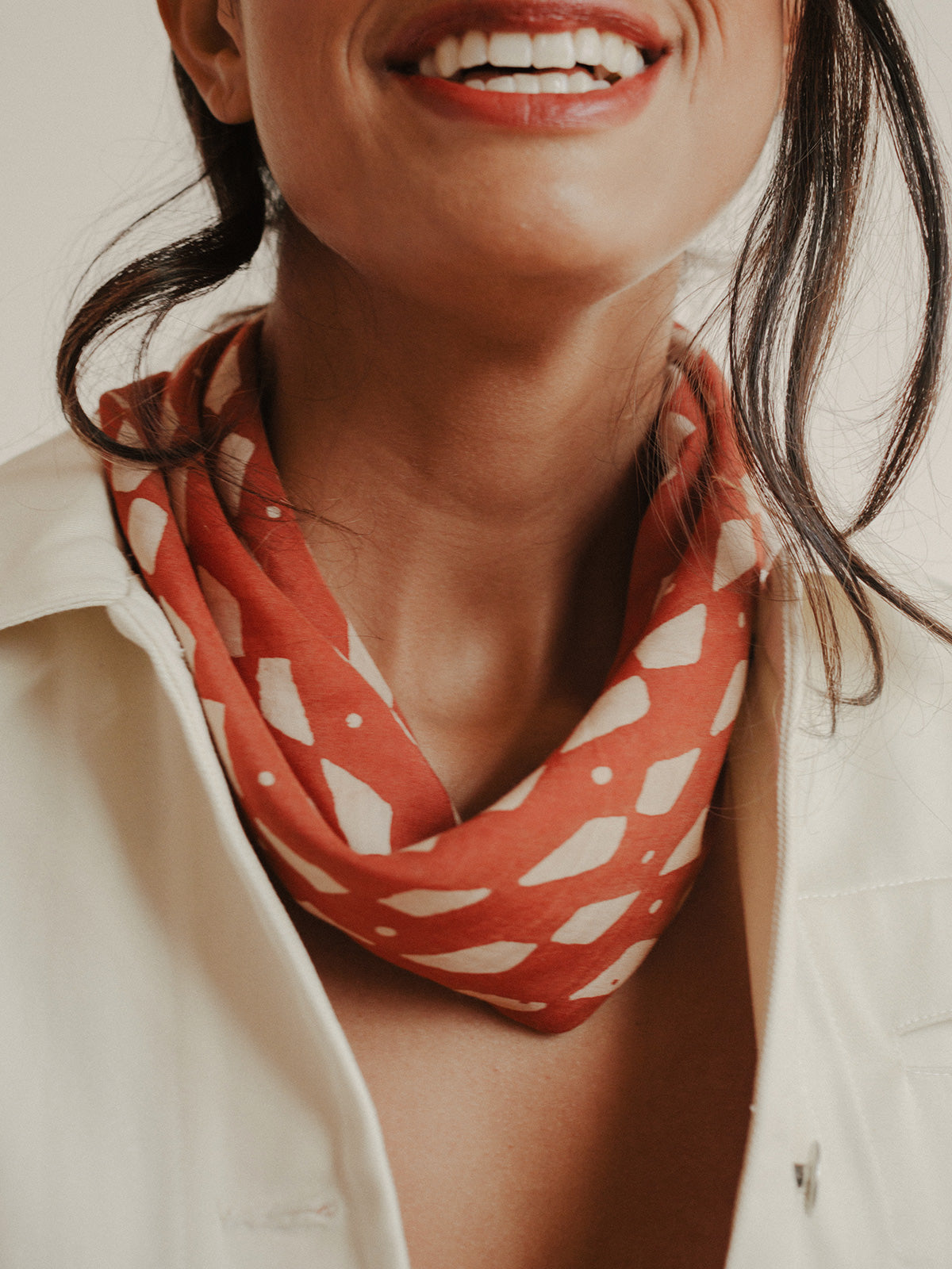 SUNDAY/MONDAY's hand block printed Domino bandana is printed with natural red dye on a super soft silk cotton blend.
