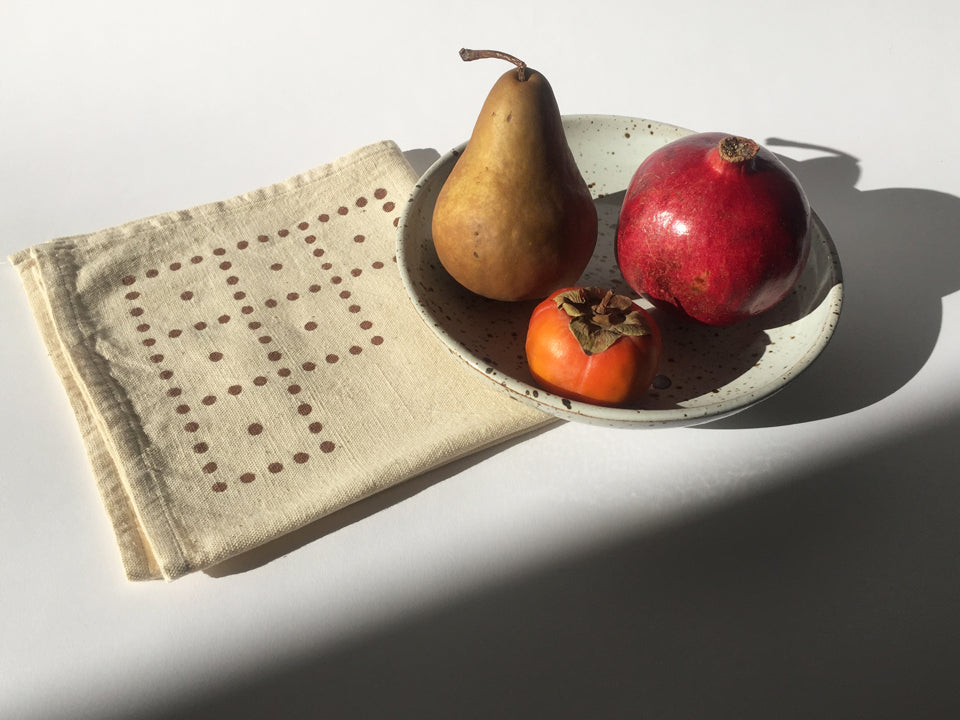 Hand block printed cotton cloth napkins with a bold geometric polka dot design.