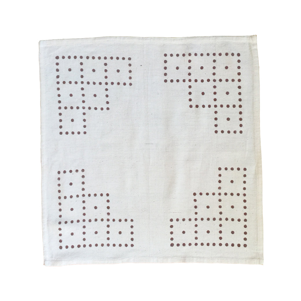 Natural block printed cotton cloth napkins with a cheery and minimal dot pattern.