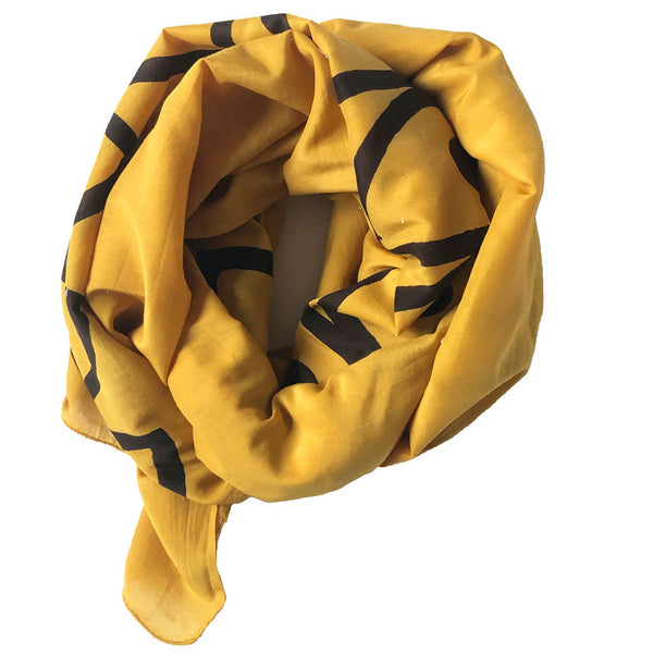 Bold new golden yellow scarf by SUNDAY/MONDAY. Hand block printed moon motif on a super soft silk cotton blend. Wear as a scarf or hang on the wall for decor.