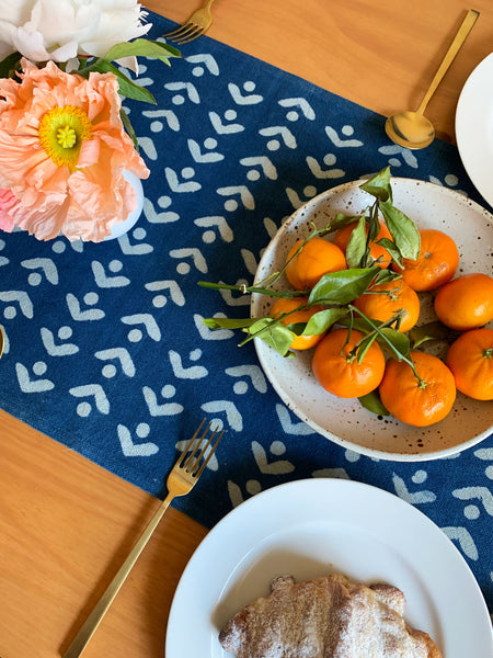 SUNDAY/MONDAY's blue and white Egret cotton table runner. Hand block printed and hand dyed with natural indigo in India. Floral inspired table runner.