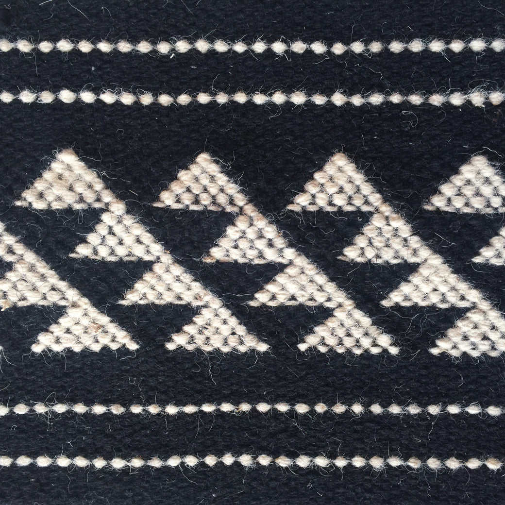 SUNDAY/MONDAY Handwoven Indian 100% Wool Rug Textile, Kuran, made in Kutch, Gujarat Black and White, featuring graphic traditional indigenous Indian motifs - detail