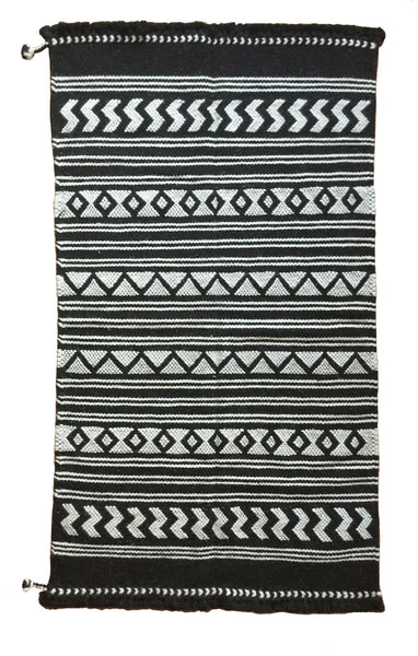 SUNDAY / MONDAY Handwoven 100% Wool Indian Flatweave Rug, Mandvi, Black and white wool area rug made in tribal indigenous traditional motifs triangle zig-zag diamond.  Handmade in Kutch, Gujarat