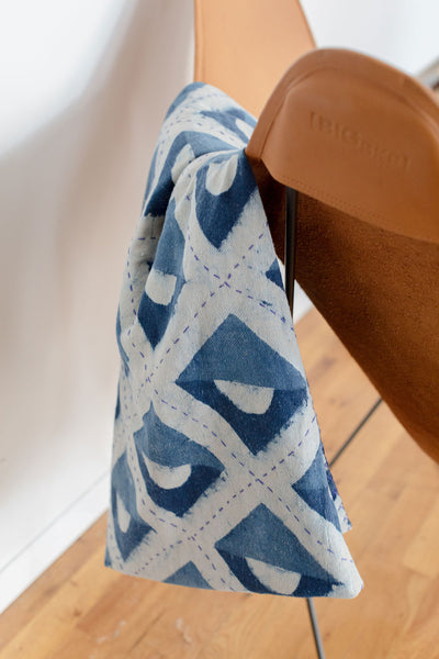 Blue and white hand block printed indigo throw featuring geometric shapes. Lightweight and easy to take with you to the beach or park, or to cuddle up with at home.