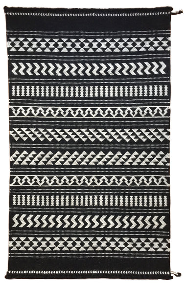 SUNDAY/MONDAY Handwoven Indian 100% Wool Rug Textile, Kuran, made in Kutch, Gujarat Black and White, featuring graphic traditional indigenous Indian motifs
