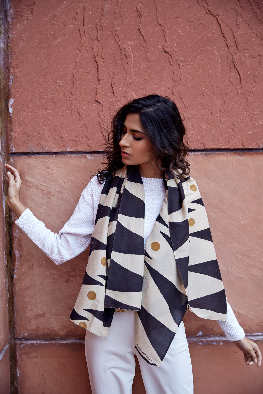 Hand block printed cotton silk scarf with a bold geometric print in black and ochre. Hand block printed with natural dyes on cotton silk.