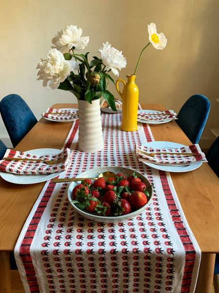 SUNDAY/MONDAY's hand block printed POPPY table runner and cloth napkins, featuring a summery red floral inspired pattern. Perfect for cozy, summer inspired brunches.