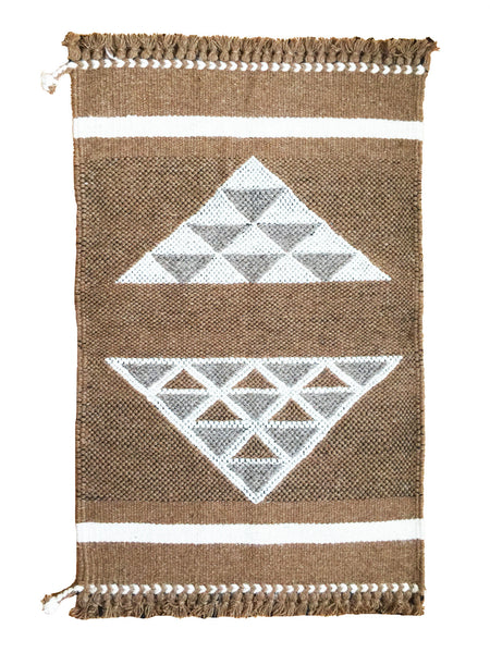 Handwoven wall hangings and rugs! 100% undyed camel and sheep wool. Made by master weavers in Kutch, India.