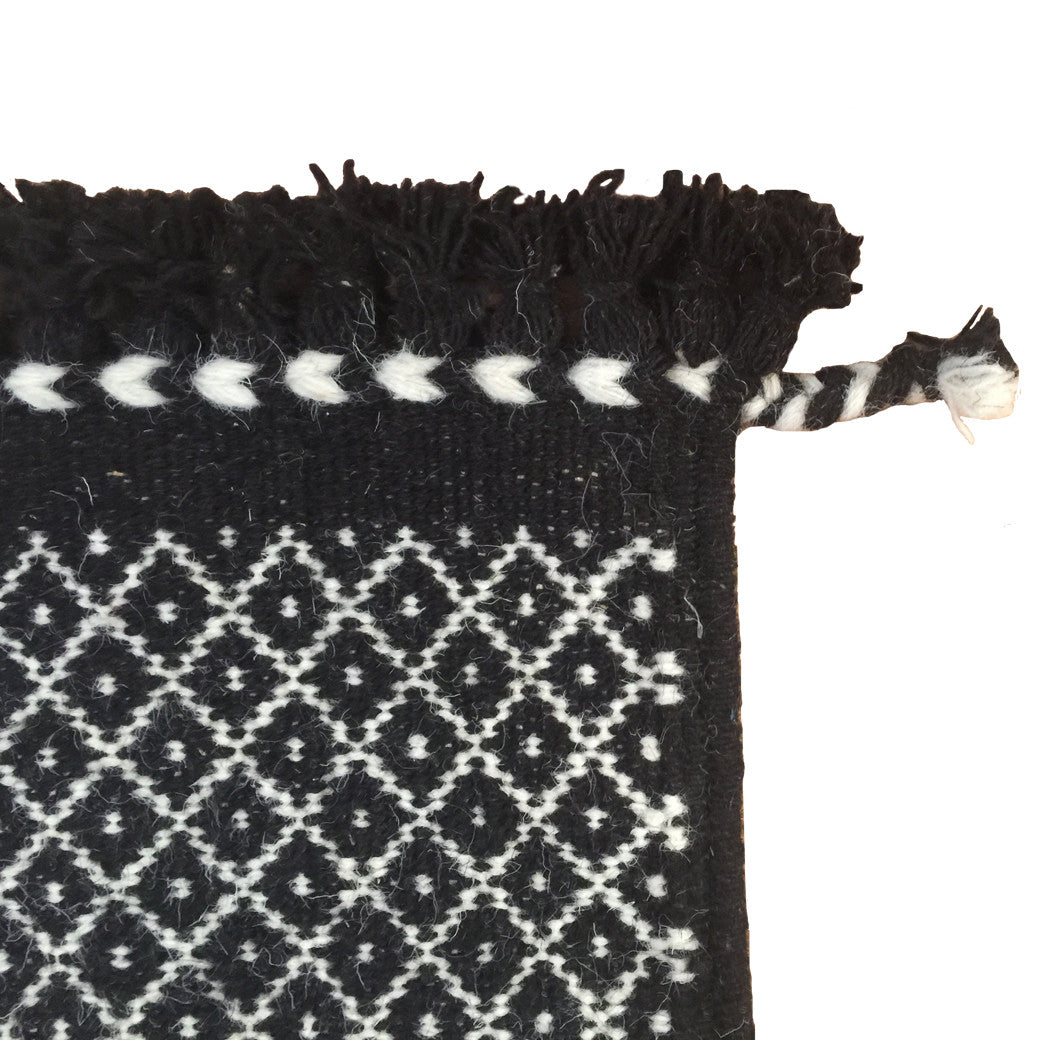 SUNDAY / MONDAY Handwoven 100% Wool Indian flatweave runner rug. Our Rann Runner comes in black with white detailing. Black and white wool area rug made in tribal indigenous lattice diamond - miri braid.  Handmade in Kutch, Gujarat