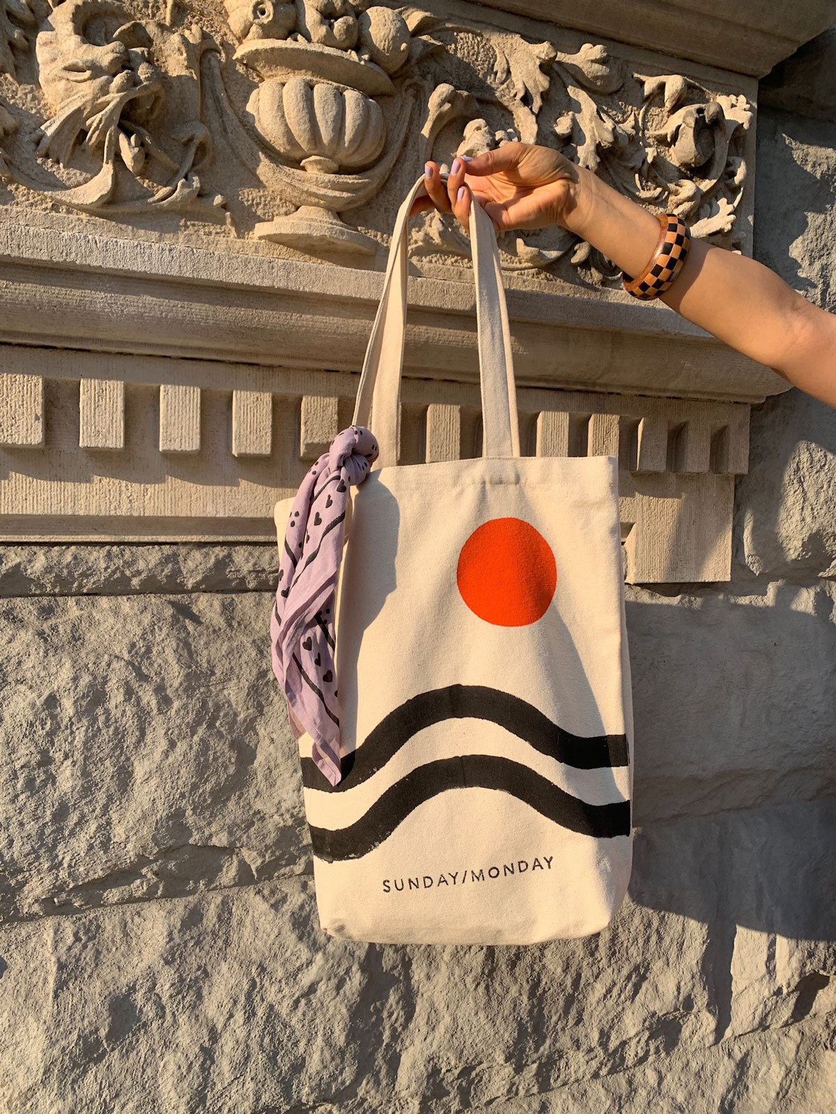 Hand block printed heavy weight canvas tote bag with a bold geometric design in red orange and black.