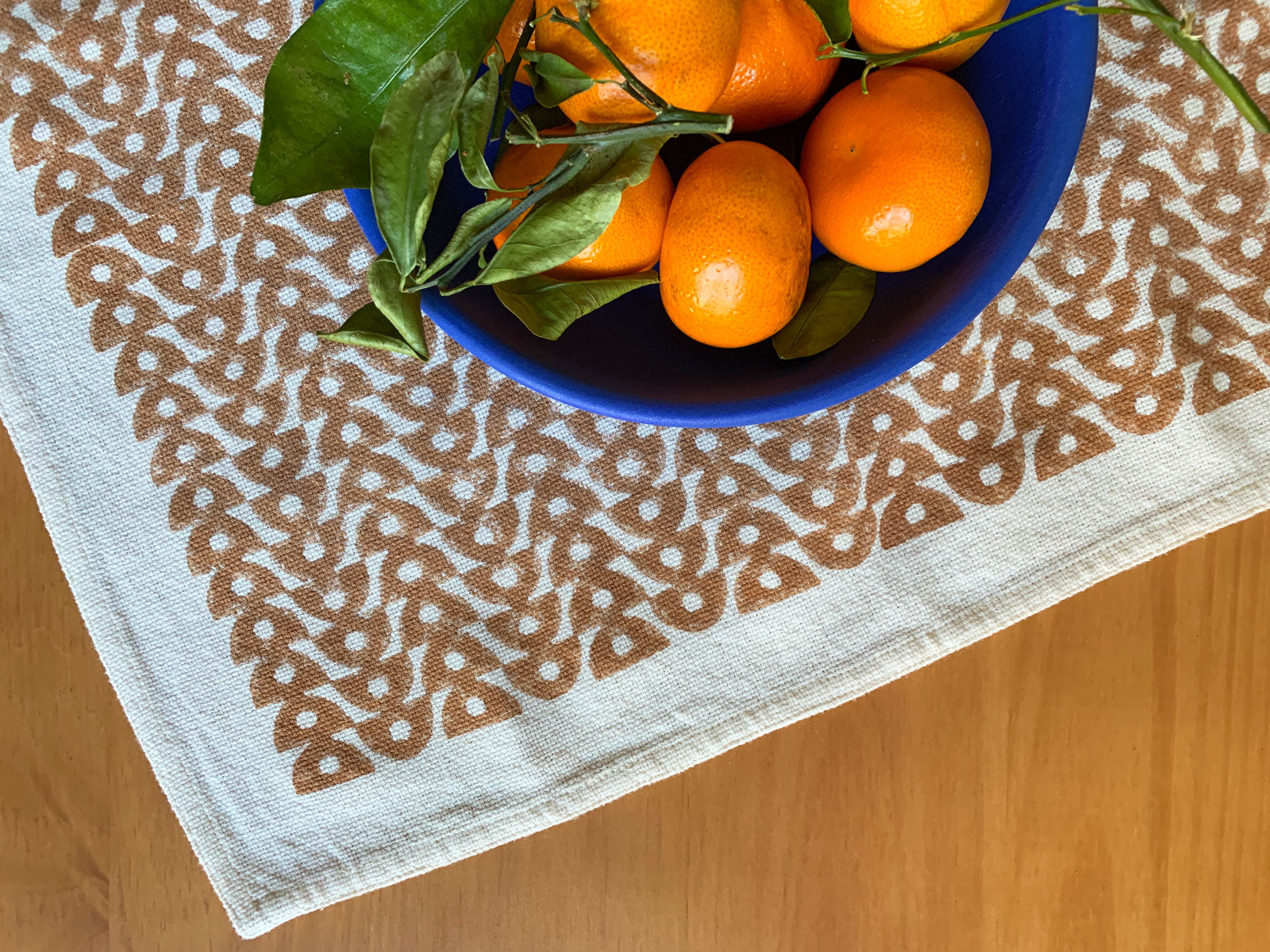 Hand block printed cloth napkins for mindful living by SUNDAY/MONDAY. Brown and natural white featuring a bold pattern.