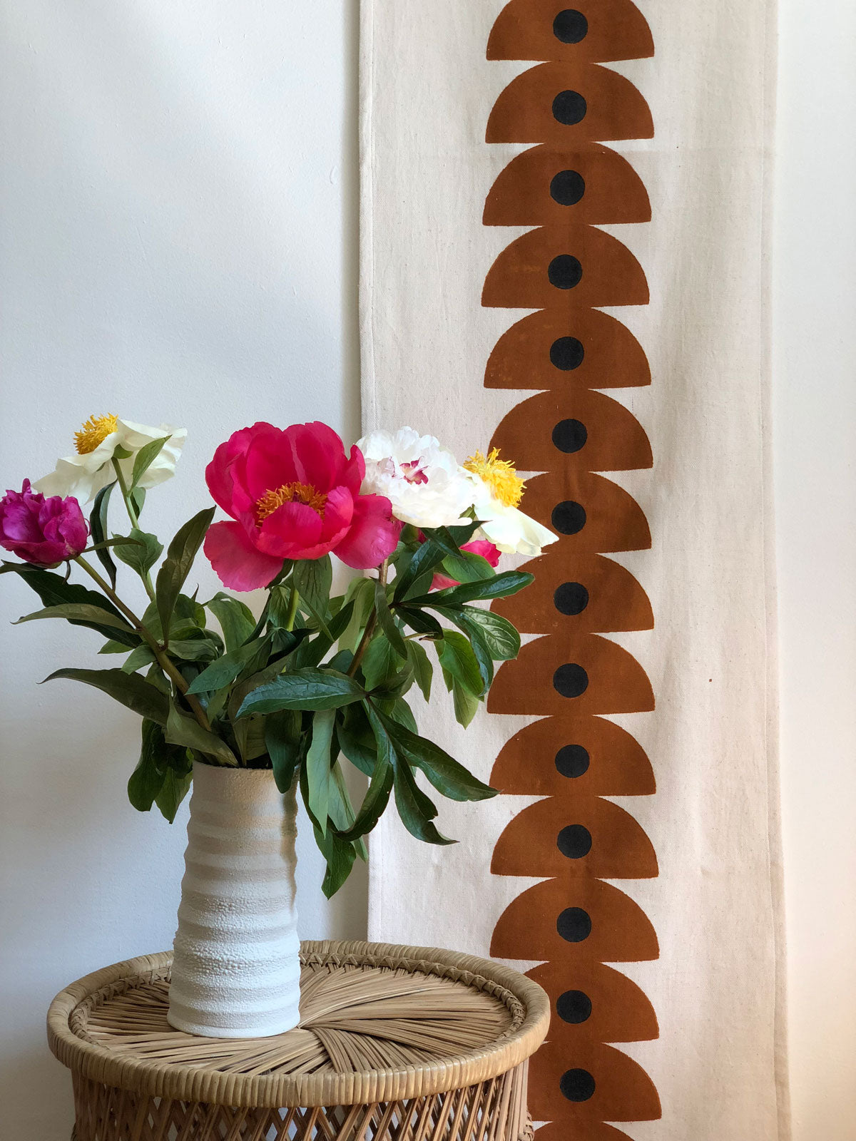 Our handwoven, hand block printed table runner doubles as a stunning wall hanging, sure to liven up any space. Handwoven and hand block printed in Gujarat, India. We work directly with the artisans to ensure our products are ethically made.