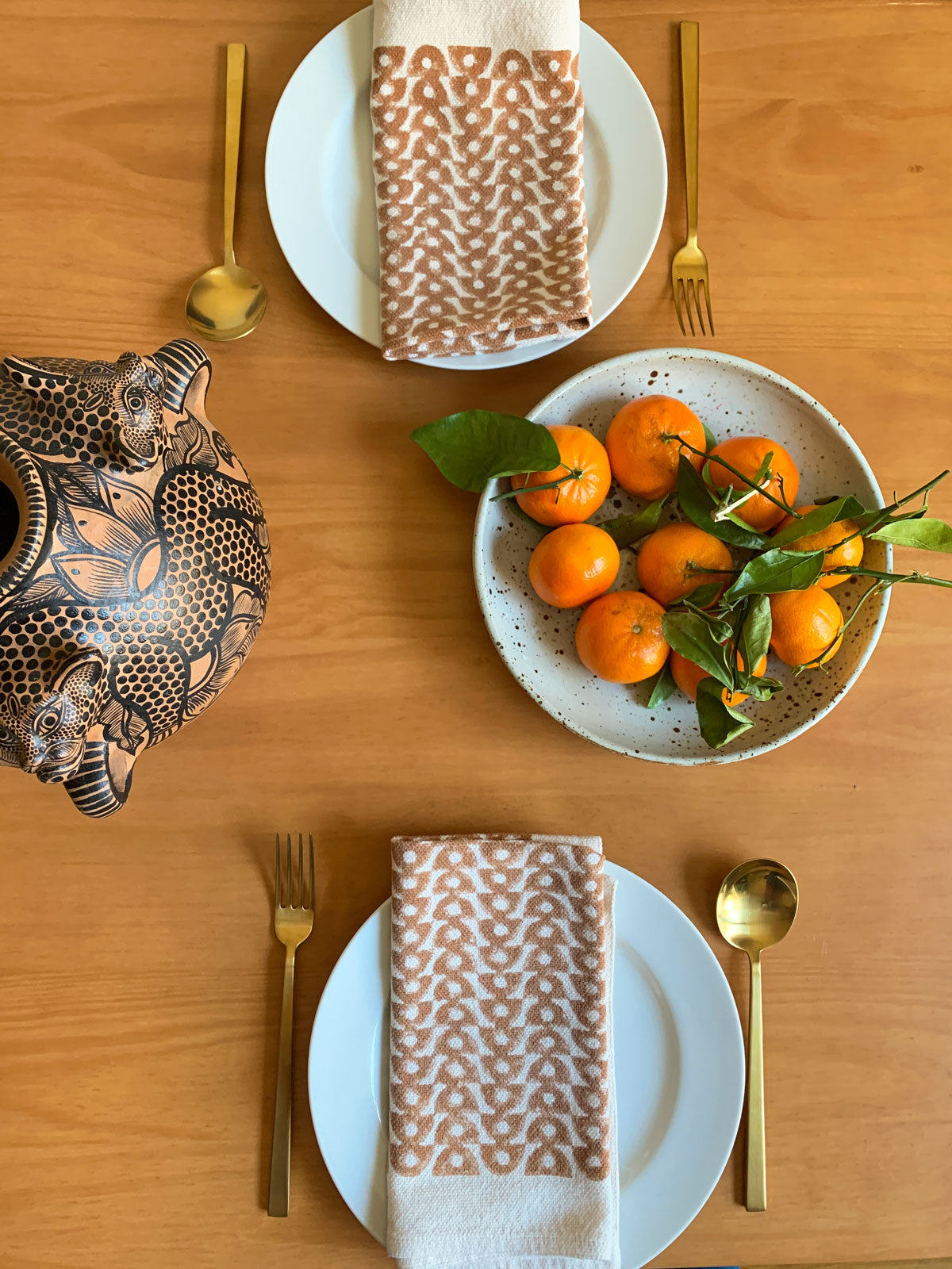 SUNDAY/MONDAY's hand block printed brown and natural white cloth napkins featuring a geometric circle pattern.