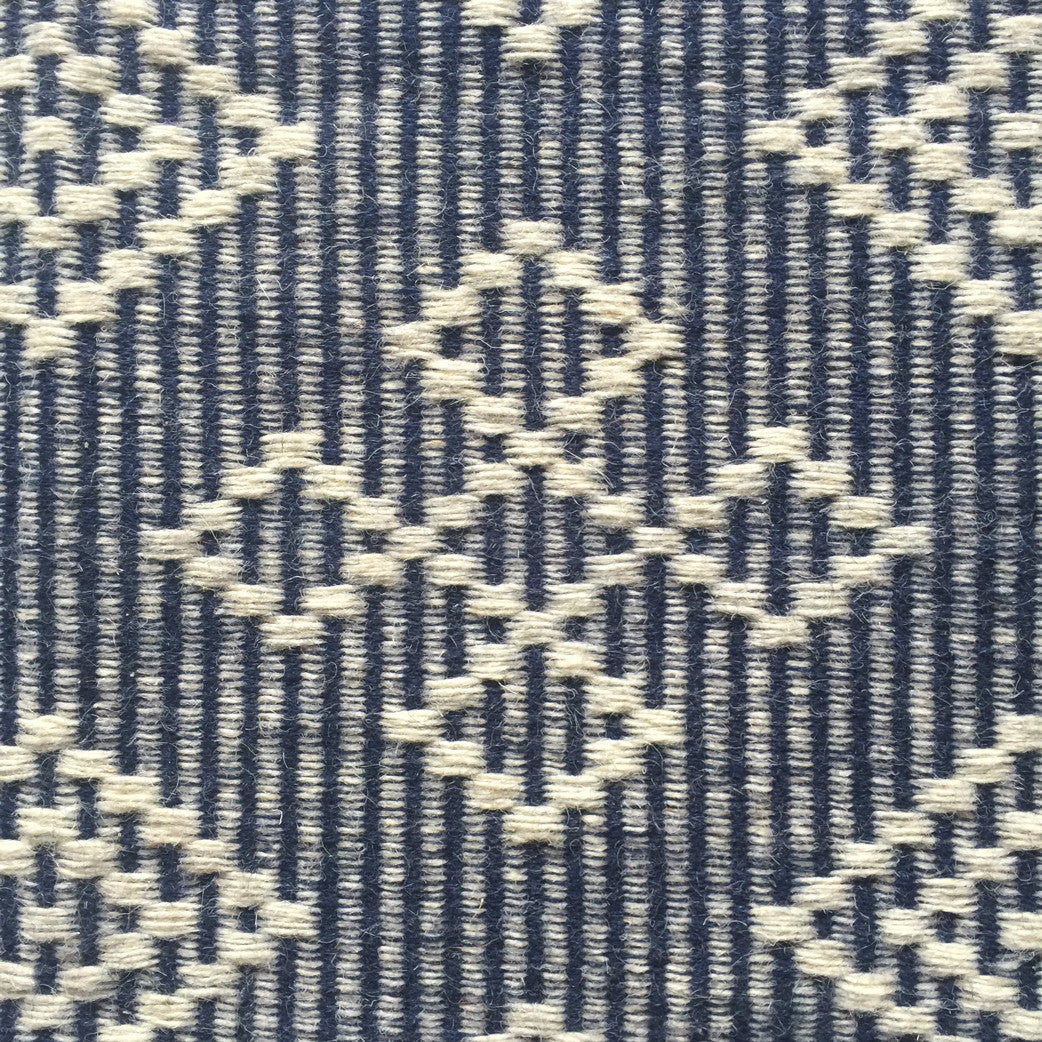 Looking for ethically made rugs? These lightweight flatweave rugs are hand dyed and handwoven by master weavers in India. The rich dark blue color adds a luxurious look to any room.