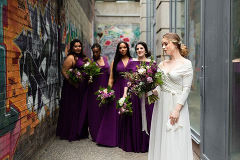 Henkaa bridal party poses in a graffiti alley outside The Richmond event space in Toronto.