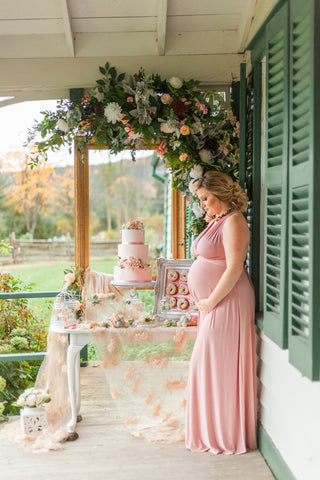 Pregnant woman at a Dusty Rose wedding