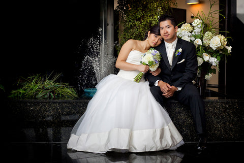 Sonia Dong and husband Khiem pose for portrait photos on the day of their wedding.