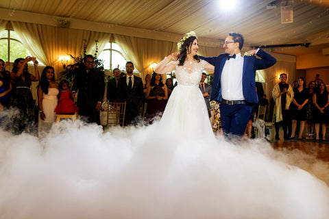 Henkaa A Bride's Story: Diana & Jas. Husband and wife share first dance with smokey dance floor.