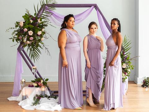 Bridesmaids wearing Henkaa Dusty Purple Bridesmaid Dresses worn on three women of varying skin tones and body types.