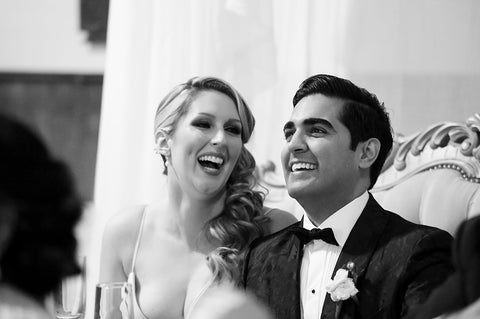 Stephanie Rochefort and Subhir Uppal laugh together at their multicultural wedding at allsaints Event Space located in Ottawa Ontario, Canada