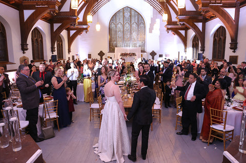 Stephanie Rochefort and Subhir Uppal hold hands as they greet their guests at their multicultural wedding reception at allsaints Event Space in Ottawa Ontario, Canada.