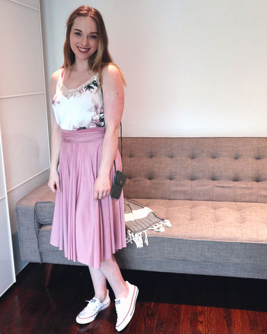 Kate Maranduik wearing the Henkaa Sakura Midi in Dusty Rose as a skirt with a floral silk camisole and white Converse sneakers.