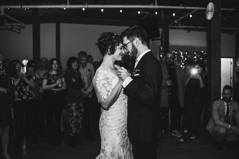 Averie MacDonald and Bled Celhyka have their first dance, photo is in black and white.