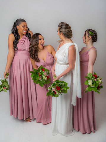 Bride and her 3 bridesmaid wearing the Henkaa Dusty Rose Infinity Dress