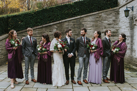 Averie and Bled pose with their wedding party. Bridesmaids are wearing Henkaa Eggplant Purple and Dusty Purple Sakura Maxi Convertible Dresses perfect for fall weddings.
