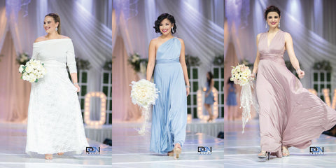 Henkaa dresses worn by models on the Canada's Bridal Show runway, left to right: Iris Lace Wrap Style Wedding Dress, Dusty Blue Sakura Maxi Convertible Dress, Mauve Taupe Sakura Maxi Convertible Dress.