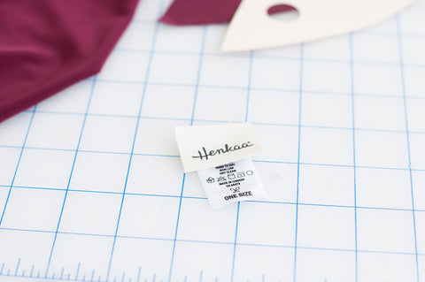 Supporting the local economy through sustainable shopping: Henkaa convertible and multiway dresses are made designed and made in Canada as seen on our tags.