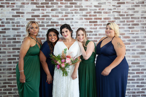 2020 Wedding Trend Report: Henkaa Ivy and Sakura convertible bridesmaid dresses in Navy Blue and Hunter Green Bride is wearing the Sakura Lace Convertible Wedding Dress.