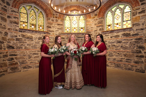 Stephanie Rochefort poses alongside her bridal party who are wearing Henkaa Burgundy Wine Sakura Maxi Infinity Dresses.