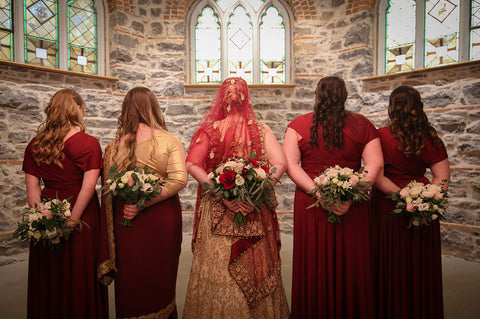 Stephanie Rochefort poses with her bridal party who are wearing Henkaa Burgundy Wine Sakura Maxi Infinity Dresses, made in Canada.