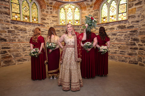 Stephanie Rochefort poses for portraits with her bridal party at allsaints Event Space in Ottawa Ontario, Canada, wearing Henkaa convertible dresses.