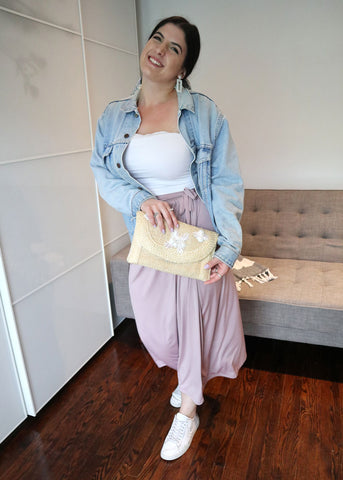 Madeleine Villa styles the Henkaa Ivy Midi as a skirt and accesorizes with a vintage straw clutch, Levi's denim jacket, and white tube top.
