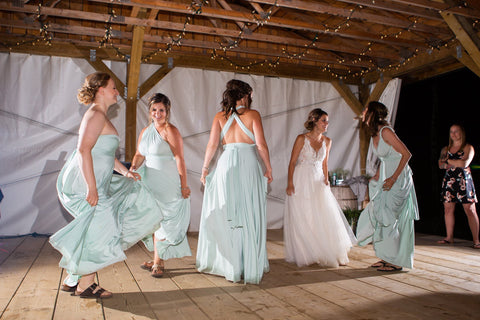 Ashley's bridesmaids dance the night away in their Mint Green Henkaa Convertible Dresses made in Canada.