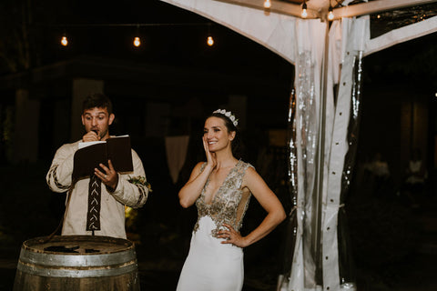 Wife, Lauren Melnik blushes as husband Alex Melnik sings his speech -a special rendition of 'Drops of Jupiter' to his new wife.