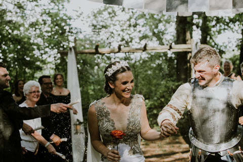 The Medieval themed wedding ceremony took place in Caledon Ontario in Alex Melniks parents forest. This wedding was featured on the Henkaa infinity dress blog.